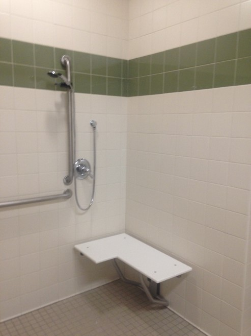 Showers are outfitted to be either used with built in seat or personal shower chair.
